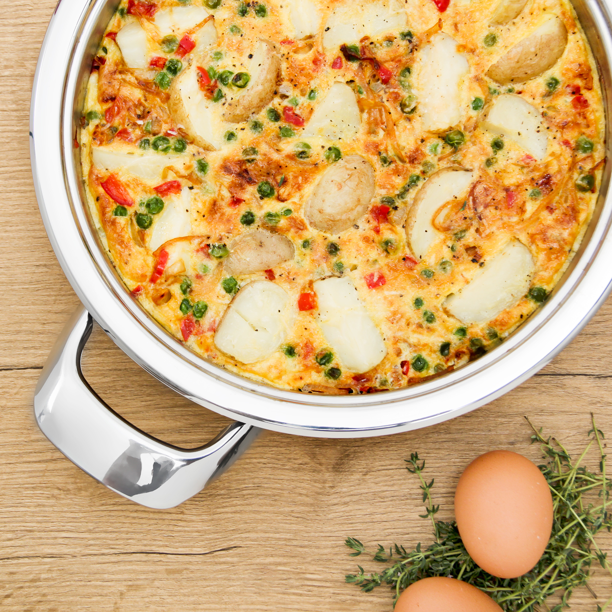 baby potato and parmesan frittata in AMC Synergy 24cm skillet