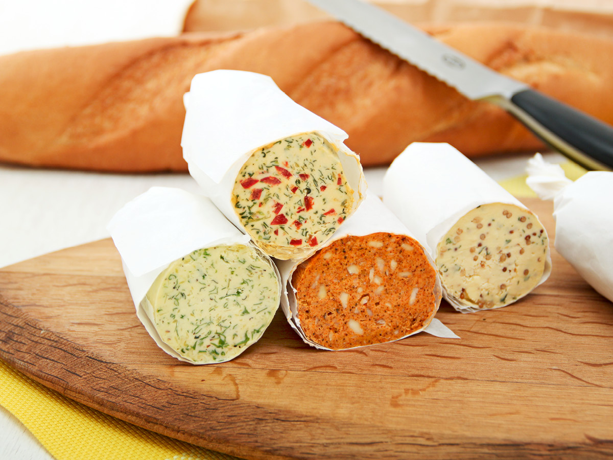 savoury flavoured butters on cutting board