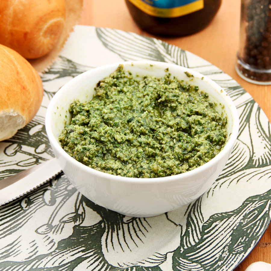 Fresh basil pesto, white bowl
